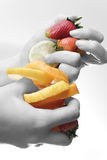 Fruits in hands Royalty Free Stock Photo