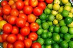 Fruits For Health. Red tomatoes and green limes good for your health Royalty Free Stock Photos