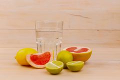 Fruits for a healthy diet with a glass of water stock image