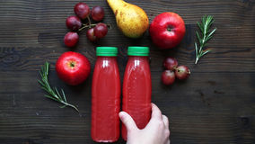 Fruits and healthy juice in bottles on brown table stock video footage