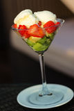 Fruits with ice-cream. In a glass bowl Royalty Free Stock Photo