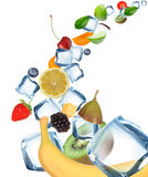 Fruits with Ice cubes in motion Royalty Free Stock Photography
