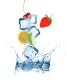 Fruits with Ice cubes splashing into the water Stock Photos