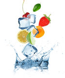 Fruits with Ice cubes splashing into the water Stock Images