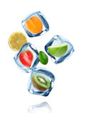 Fruits in Ice cubes splashing into the water Stock Photo