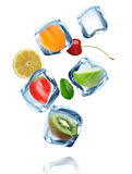 Fruits in Ice cubes splashing into the water Stock Photos