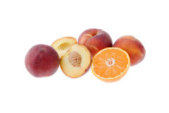 Fruits isolated. Some peaches and a orange isolated on white background Royalty Free Stock Image