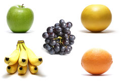 Fruits isolated on white. Apple, grapefruit, bananas, orange, grapes isolated on white background royalty free stock photography