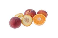 Fruits isolates. Some peaches and a orange isolated on white background Royalty Free Stock Photo