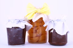 Fruits jam. A closed glass of raspberry jam against white. File contains clipping path stock photos