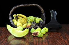 Fruits and jug with wine Stock Image