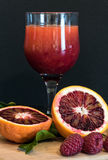 Fruits and juice. Blood orange, berries and a glass of freshly squeezed juice Stock Photos