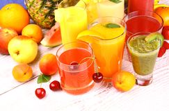 Fruits juice with cherry, apricot, kiwi, watermelon and orange. Juice from cherry, apricot, kiwi, watermelon and orange, top view Stock Images