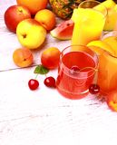 Fruits juice from cherry, apricot and orange Royalty Free Stock Photo