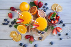 Fruits and juice. Fresh orange juice and berry Royalty Free Stock Images