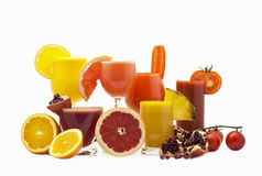Fruits and juice in glass Stock Images