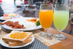 Fruits juice on the table in breakfast time. Fresh fruits juice on the table in breakfast time Royalty Free Stock Photography