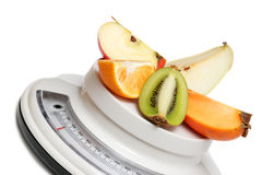 Fruits on kitchen scales Royalty Free Stock Photography