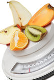Fruits on kitchen scales Stock Photography