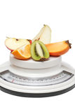 Fruits on kitchen scales Royalty Free Stock Photo
