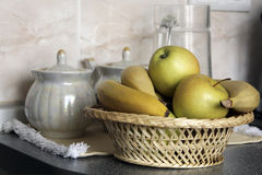 Fruits on the kitchen table. Fruits in the busket on the kitchen table stock images