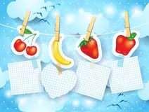 Fruits and labels on sky background Royalty Free Stock Photos