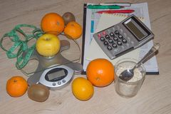 Fruits, Libra, calculator and centimeter on a white background. Diet concept Royalty Free Stock Photo