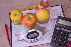 Fruits, Libra, calculator and centimeter on a white background. Diet concept. Ts, Libra, calculator and centimeter on a white background. Diet concept. Low-fat Stock Photos