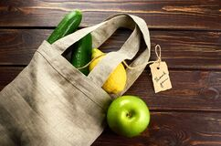 Fruits in linen reusable textile shopping bag with thank you lable. Zero waste shopping, recycling concept