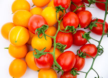 Fruits: little orange and cherry tomatoes Royalty Free Stock Photography