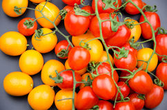 Fruits: little orange and cherry tomatoes Royalty Free Stock Photo