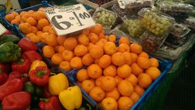 Fruits at local market. Pepper oranges grapes royalty free stock photo