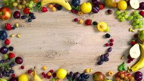 Fruits made letter A. The composition of bright ripe fruits. Alphabet on a table stock video footage