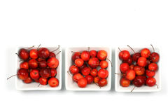 Fruits of the Malus Pumila (crab apple). In  white bowls Stock Photo