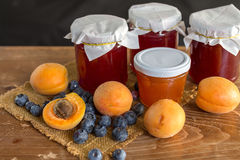 Fruits and marmalade. Apricots, blueberries and strawberry marmalade Stock Photos