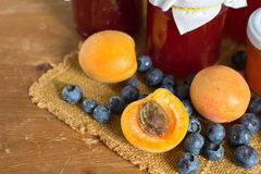 Fruits and marmalade. Apricots, blueberries and strawberry marmalade Stock Photography