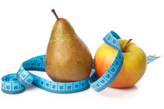 Fruits and measure tape Stock Photo