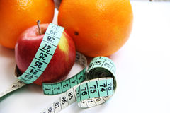 Fruits and measurement tape on the white background Royalty Free Stock Photo