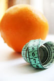 Fruits and measurement tape on the white background Stock Photography
