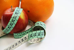 Fruits and measurement tape on the white background Stock Images