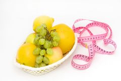 Fruits and measuring tape Stock Photography