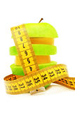 Fruits and measuring tape. royalty free stock photos