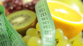 Fruits and measuring tape close up. The concept of diet stock video