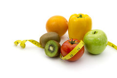 Fruits and measuring tape Stock Images