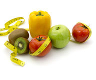 Fruits and measuring tape Stock Photo