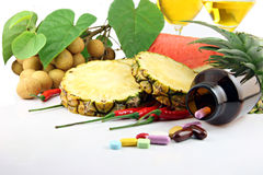Fruits and medicines placed near the cosmetics. Fruits and medicines placed near the cosmetics on white background Royalty Free Stock Photo