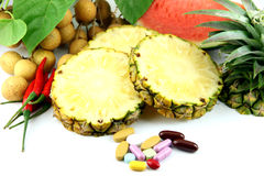 Fruits and medicines placed near the cosmetics. Royalty Free Stock Image