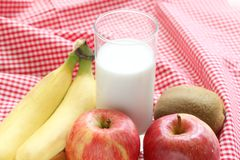 Fruits and milk Stock Images