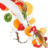 Fruits in milk and chocolate splash. Over white background Stock Photography