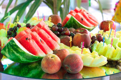 Fruits on mirror stand Stock Photos